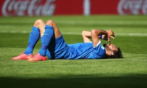 Giorgos Samaras of Greece reacts after falling to the ground against Colombia.