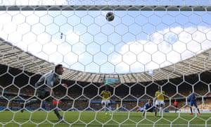Greece's Fanis Gekas heads the ball against the bar.