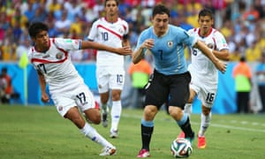 Cristian Rodriguez of Uruguay controls the ball against Yeltsin Tejeda of Costa Rica.