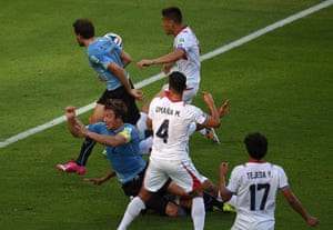 Uruguay's defender Diego Lugano falls after being brought down by Costa Rica's defender Junior Diaz.