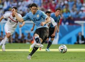 Uruguay's Edinson Cavani scores the opening goal.