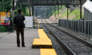 Unaware of the work stoppage, a man waits for a Septa commuter train at the East Falls commuter rail station in Philadelphia.