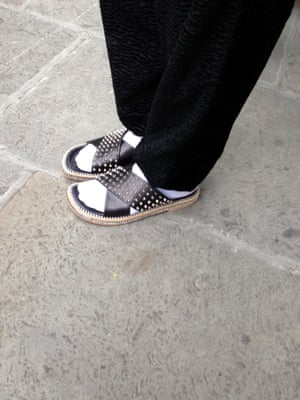 Next level socks and sandals outside the shows.