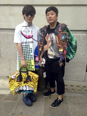 Chinese buyers wearing Raf Simons (left) and a new Thai designer and a Jeremy Scott for Longchamp bag. London Men's Fashion Week SS15, 15th June 2014 lcmplog