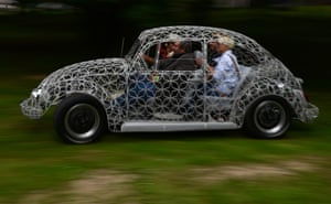 Prague, Czech Republic: A wire-bodied Volkswagen Beetle is driven at the Legendy motoring festival.
