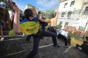 Kiev, Ukraine: Protesters pelt the Russian embassy with missiles during a rally.