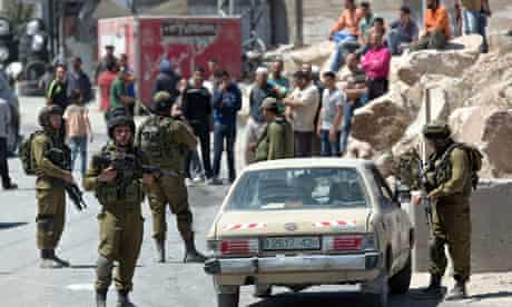 Israeli soldiers man a checkpoint