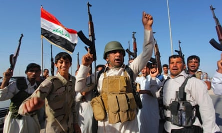 Tribal fighters shout slogans in support of Iraqi security forces during clashes with Sunni militant group Isis.