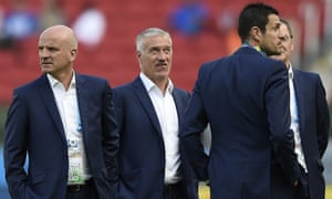 France's assistant coach Guy Stephan, head coach Didier Deschamps and goalkeepers' coach Franck Raviot inspect the pitch ahead of the Group E football match between France and Honduras at the Beira-Rio Stadium in Porto Alegre.