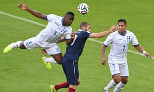 Honduras' defender Maynor Figueroa. left, jumps on the back of France's Karim Benzema to win teh ball.