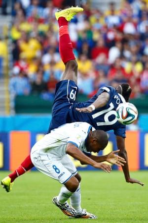 France's Paul Pogba clashes with Wilson Palacios.