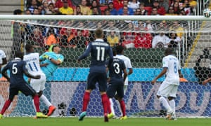 A shot from France's Blaise Matuidi is turned onto the bar by the keeper.