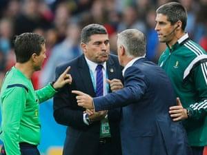 Honduras coach Luis Suarez and France coach Didier Deschamps argue about the second goal.
