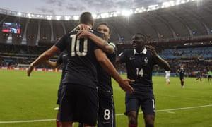 Benzema celebrates with Mathieu Debuchy and Mathieu Valbuena and midfielder Blaise Matuidi.