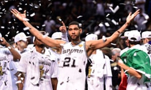 San Antonio Spurs' longtime leader Tim Duncan strikes a pose as his team celebrates his team's fifth championship.