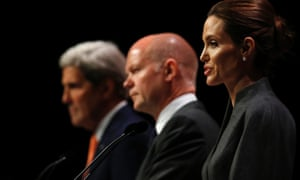 William Hague (centre) with Angelina Jolie and US secretary of state John Kerry at the summit to end sexual violence in conflict last week.