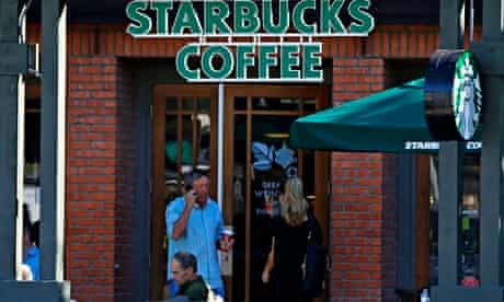 Customers visit a Starbucks coffee shop in Del Mar, California