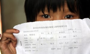 A Chinese kid shows her blood test report which showed there was excessive levels of lead in her blood, in Hengjiang village, Wugang city, central Chinas Hunan province, Tuesday, August 18, 2009. Authorities in central Chinas Hunan Province have shut down a smelter and detained two of its executives after more than 1,300 local children were suspected to have lead poisoning, the second such scandal in the country within a month.