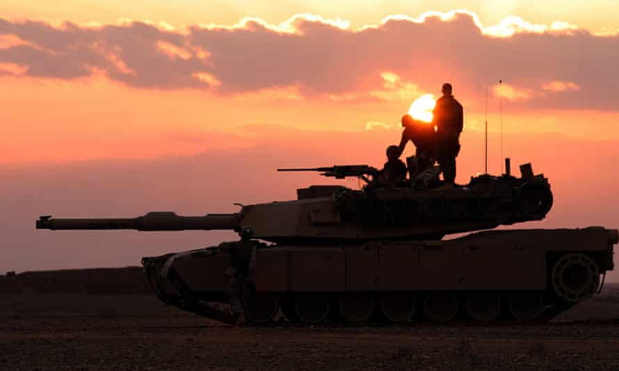 U.S. Marines with the 2nd Tank Battalion provide security with an M1A1 Abrams battle tank along the Iraqi-Syrian border in this photo released on March 11, 2005.
