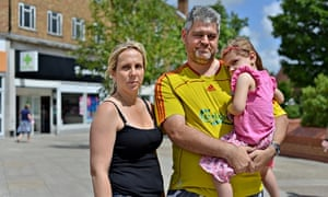 Angie Strange and Mike Lyne with their daughter