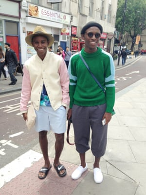 Jalan and Jibril Durimel. Two Parisian dudes who have just given us a lesson in the art of pool slides and thrift shopping. Note the insouciant clutch and the matching grins. London Men's Fashion Week SS15, Day 2, 16th June 2014 lcmplog