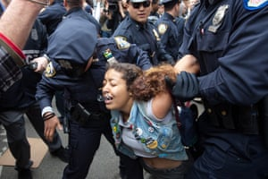 A protester carried away after being arrested by police during an Occupy Wall Street march from Zuccotti Park to Union Square.