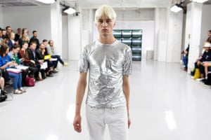 A model appears on the catwalk during a presentation by COMMON on day two of London Collections Men at the BFC presentation space, Victoria House, London. PRESS ASSOCIATION Photo. Picture date: Monday June 16, 2014. Photo credit should read: Justin Tallis/PA Wire lcmplog