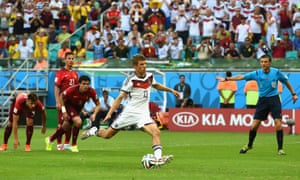 Thomas Mueller of Germany scores from the penalty spot.
