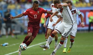 Germany's defender Benedikt Hoewedes fights for the ball with Portugal's forward Nani