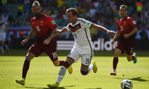 Raul Meireles challenges Germany's forward Mario Goetze for the ball