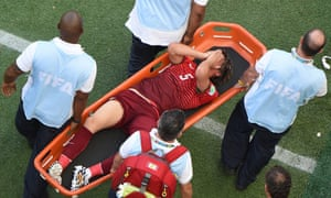 Portugal's defender Fabio Coentrao is stretchered off