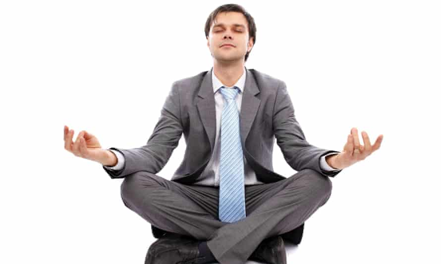 guy in suit doing yoga