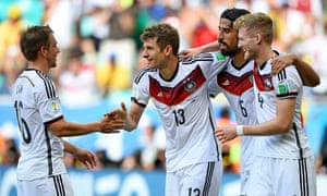 Thomas Mueller of Germany celebrates with team-mates after scoring the team's fourth.