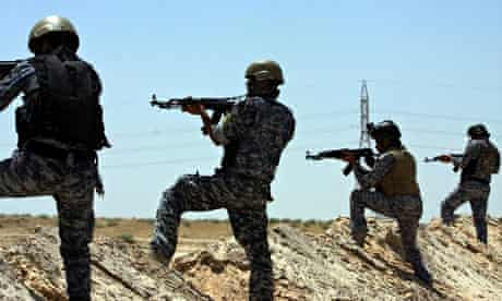 Iraqi security forces patrol near the border between Karbala province and Anbar province today