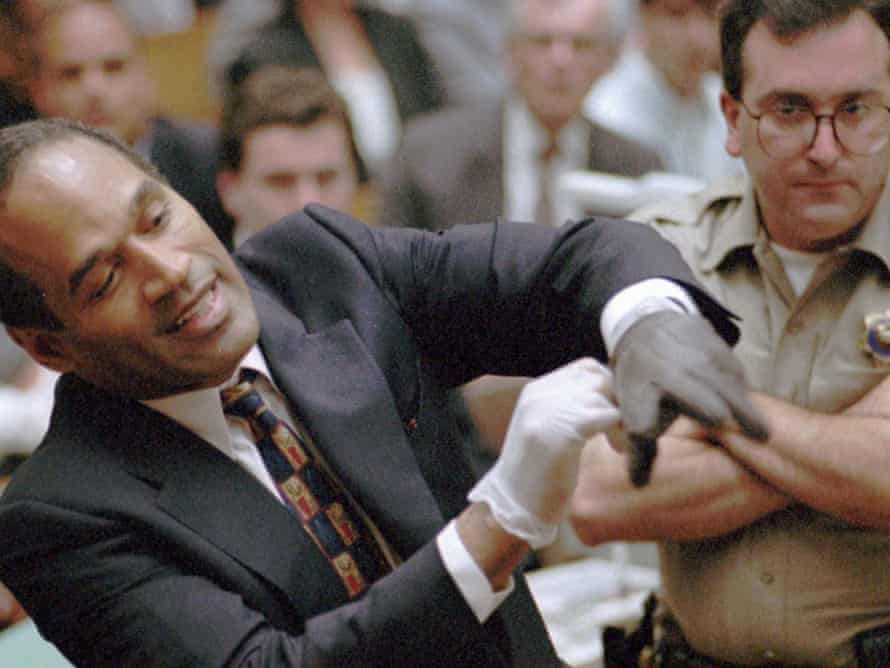 Murder defendant OJ Simpson grimaces as he tries on one of the leather gloves prosecutors say he wore the night his ex-wife Nicole Brown Simpson and Ron Goldman were murdered, during the Simpson double-murder trial Thursday, June 15, 1995, in Los Angeles. (Photo: Sam Mircovich / AP)