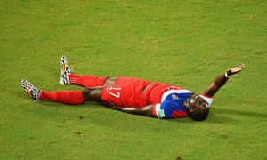 An injured Jozy Altidore of the United States lies on the field.