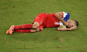 US forward Clint Dempsey gestures in pain after colliding with Ghana's defender John Boye.