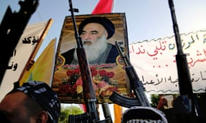 Shia tribal fighters carry a poster of Shia spiritual leader Grand Ayatollah Ali al-Sistani, as they raise their weapons chanting slogans against the al-Qaida-inspired Islamic State of Iraq and the Levant in Basra.