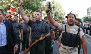 Iraqi Shia men shout slogans in support for the call to arms in Baghdad.