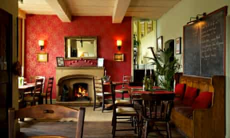 Fireplace, chairs and a pew at the Parkers Arms, in Lancashire