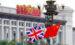 The Union Jack and the Chinese national flag flutter on a lamppost on the Tiananmen Square in Beijing, China, 9 November 2010.