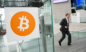 A man enters a bitcoin conference in New York.