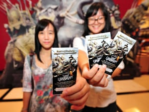 Happy children proudly hold their free tickets for the film 'The Legend of King Naresuan 5'