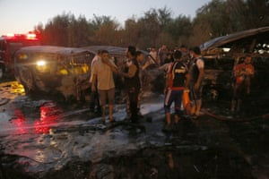 Iraqis gather at the scene of a car bomb attack in Sadr city, northeast of Baghdad, Iraq, 17 June 2014.