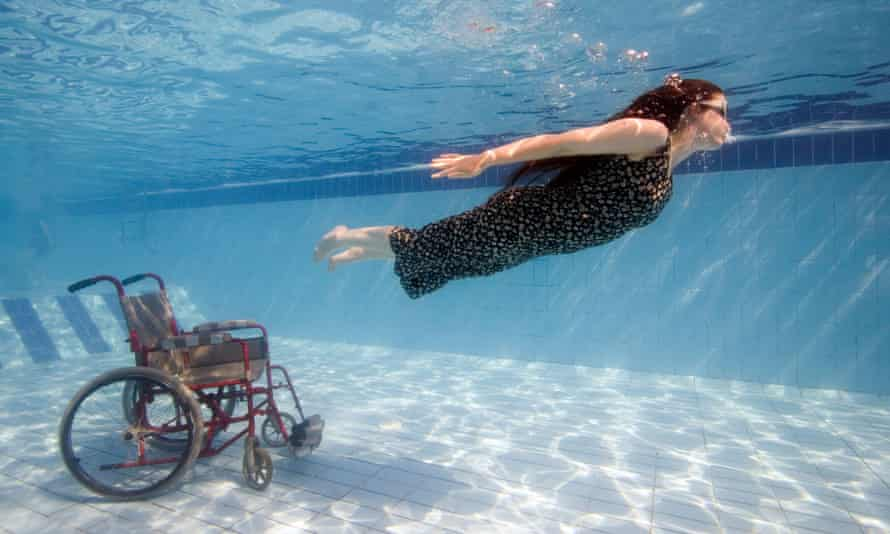 A disabled diver breaks free from her wheelchair.