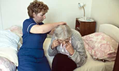 district nurse assisting an old woman at home