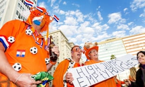 Dutch supporters cheer at the orange square in Porto Alegre.