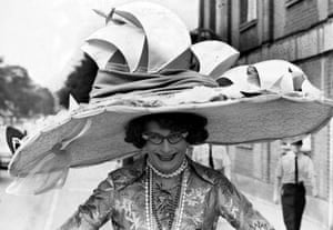 """Dame Edna Everidge shows off a new hat at Ascot races, Britain - 1976"""