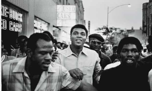 Muhammad Ali in New York with members of the Black Panther Party in September 1970. Ali was sentenced to five years in prison and his boxing championship title revoked after he refused to serve  in Vietnam. The decision was overturned in 1971.