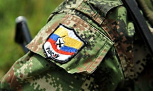 A Farc badge on the uniform of a former guerrilla